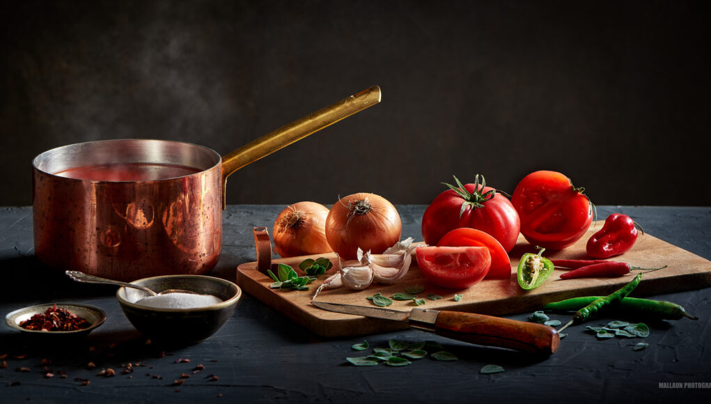 Tomato soup with tomatoes garlic onions and chili - dark food photography